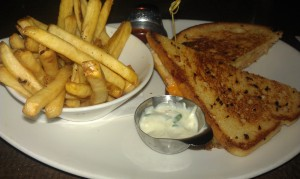 Moxie's Lobster and Brie Sandwich with Fries and Basil Mayo.