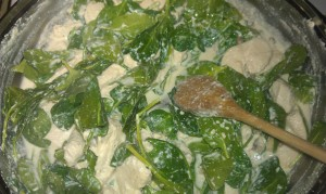Baby spinach in to the pan.