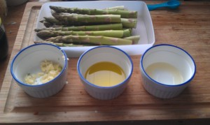 From top: One pound fresh asparagus, snapped and washed, three cloves minced garlic, 1.5 tablespoons extra-virgin olive oil and 1 teaspoon lemon juice