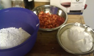 Starting left: Softened cream cheese and powdered sugar, chopped strawberries, and whipped topping.